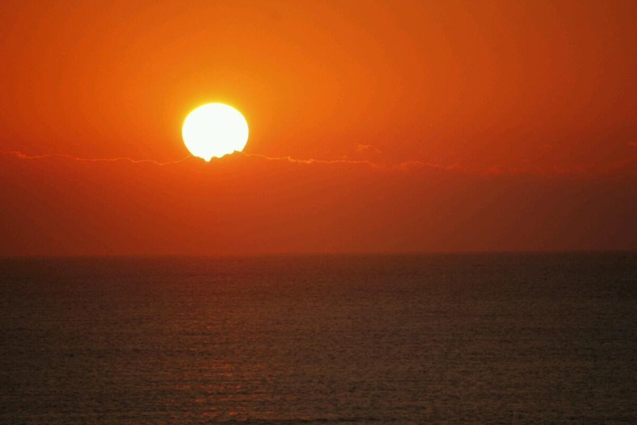 sun, sunset, sea, beauty in nature, orange color, scenics, nature, horizon over water, sunlight, water, outdoors, tranquil scene, no people, idyllic, tranquility, sky, beauty, awe, horizon, yellow, vacations, refraction, day