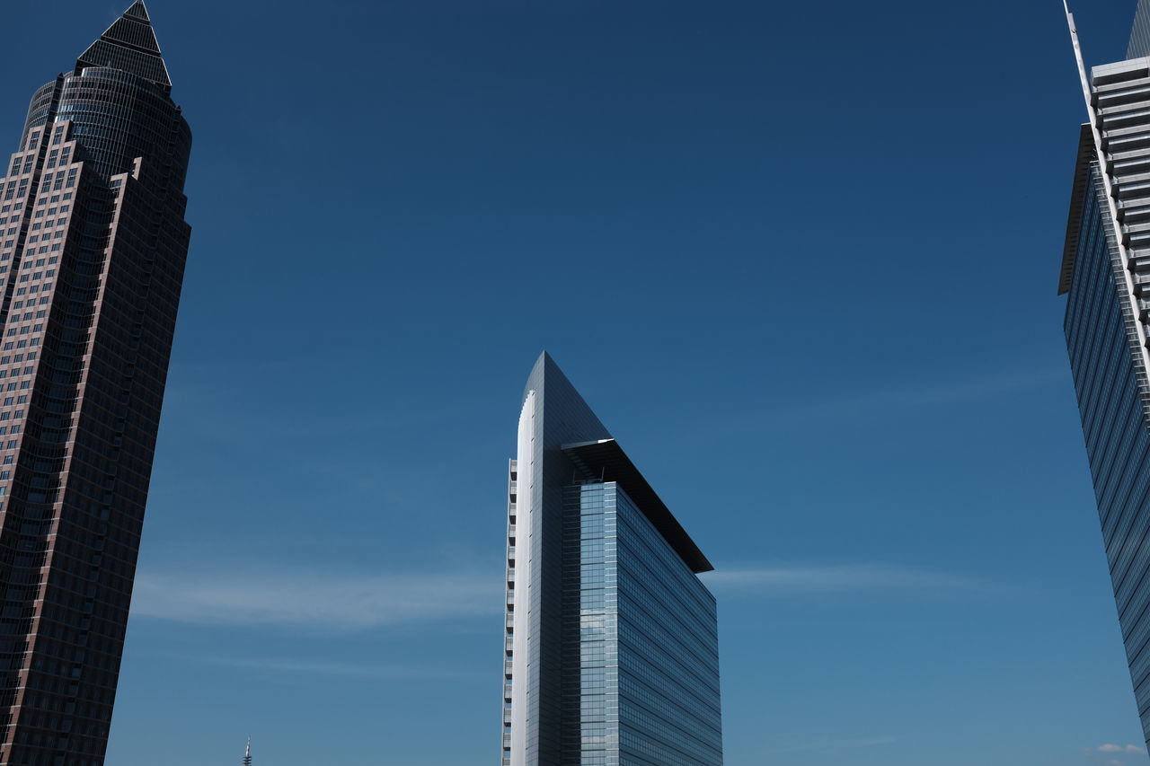 Low Angle View Of Messeturm Against Blue Sky