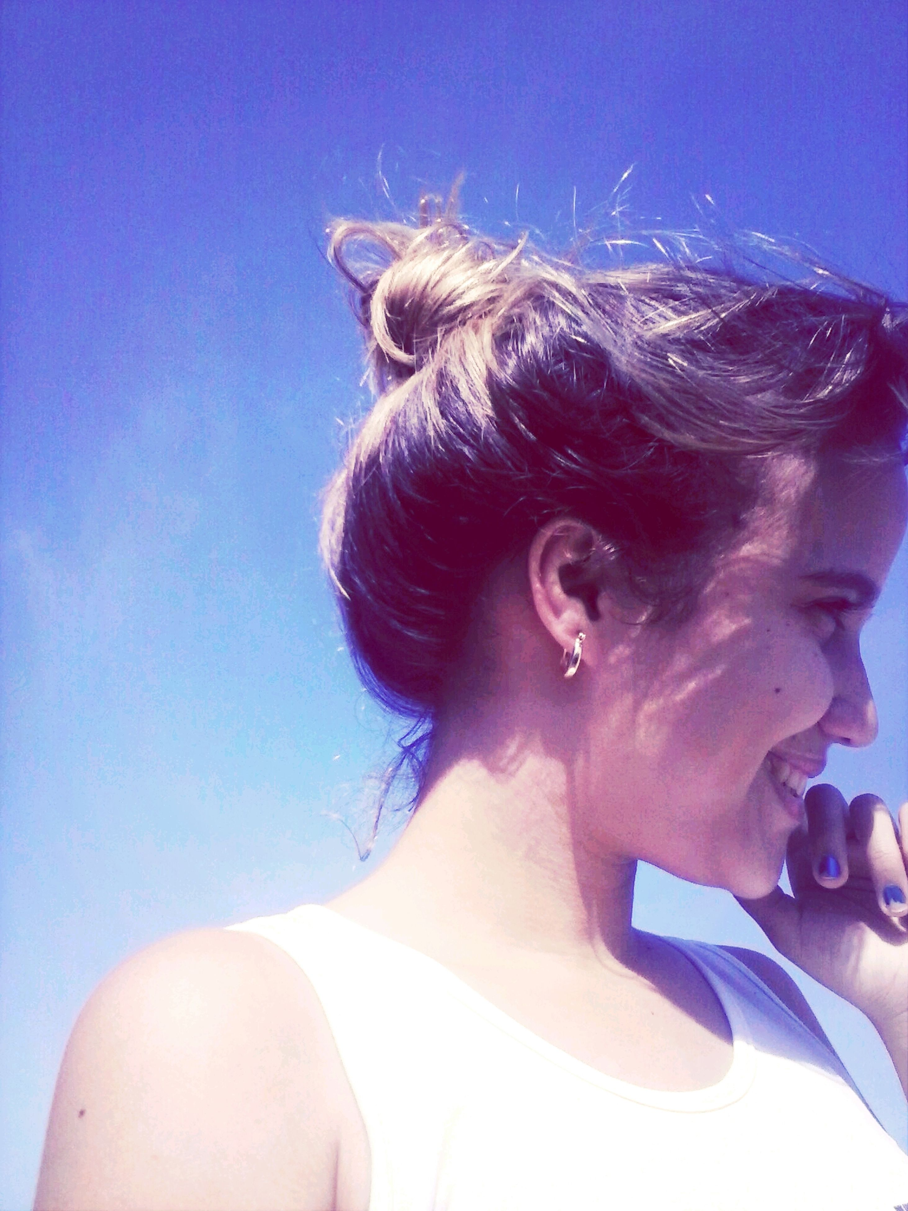young adult, lifestyles, person, leisure activity, blue, headshot, young women, portrait, looking at camera, front view, clear sky, sunlight, head and shoulders, smiling, sunglasses, low angle view, long hair, happiness