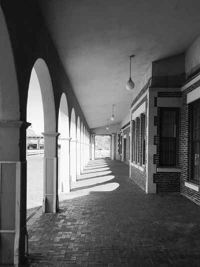 """Bygone Days"" Columns along an outside walkway at the historic Barstow Harvey House 'Casa Del Desierto' which opened in 1911 and closed in 1971. Route 66 Harvey House Historical Building Historic Hotel Blackandwhite Blackandwhite Photography"