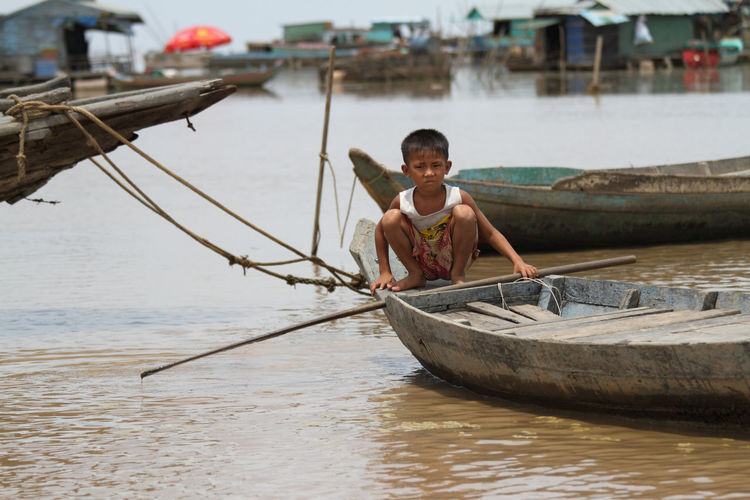 Boat Cambodia Child Day Floating House Green Kampong Khleang, Cambodia Lake Mode Of Transport Nature Nautical Vessel One Person Outdoors Portrait River Rural Scene Sitting Tonle Sap Transportation Water Young Boy