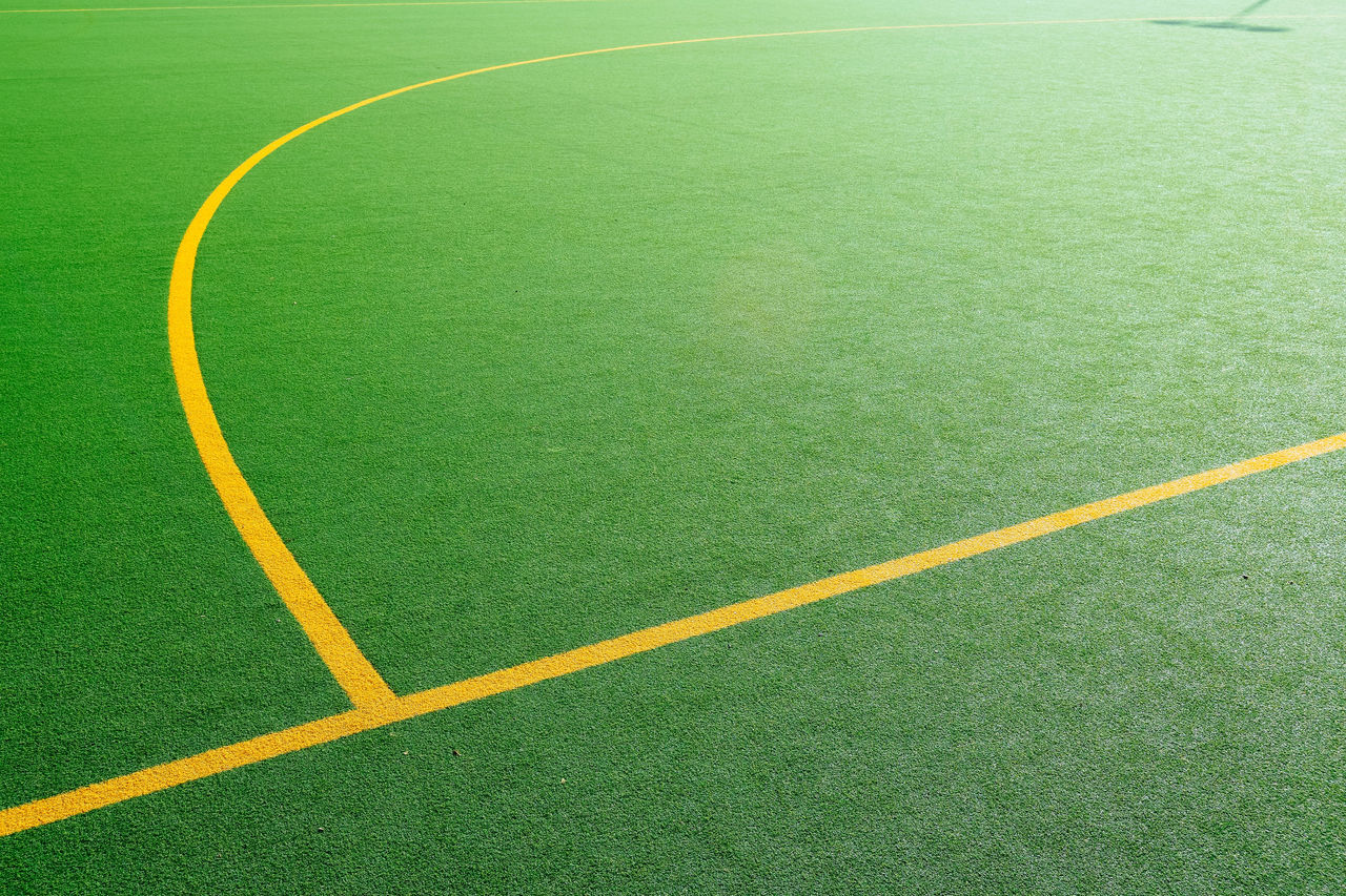 Artificial Grass Curves And Lines Day Football Grass Green Color Natural Light No People Outdoors Playing Field Soccer Sport Stadium Astro Turf Sports Court Line Marking Yellow Yellow Line
