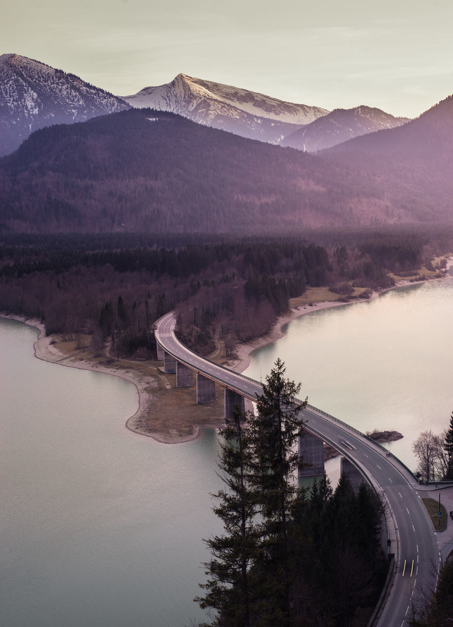 mountain, water, tree, bridge - man made structure, beauty in nature, nature, river, road, transportation, scenics, connection, sky, no people, outdoors, built structure, mountain range, tranquility, landscape, day, architecture