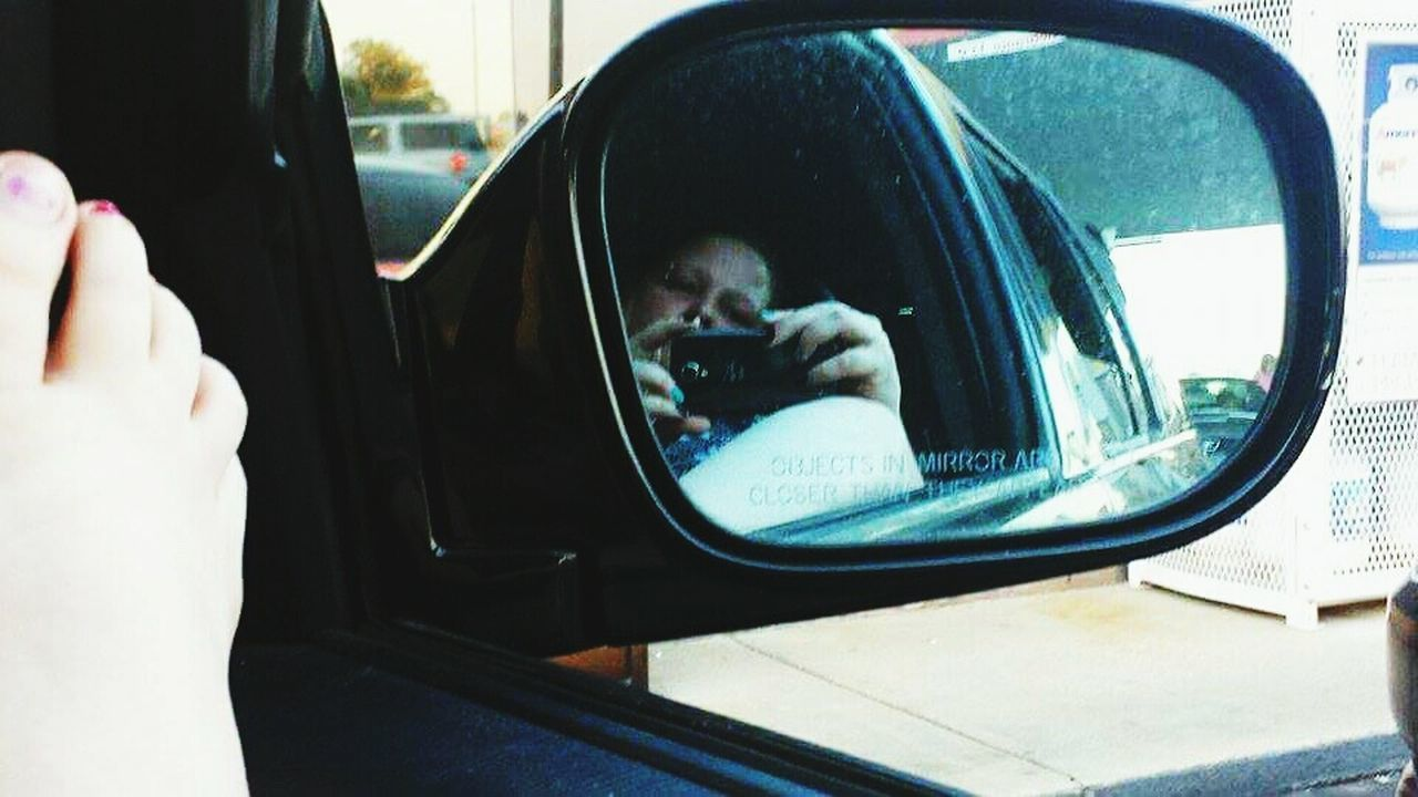 Mobile Conversations Car Reflection One Person Adult Headshot Smart Phone Wireless Technology Portable Information Device Odd Beauty EyeEmNewHere Eyeemphotography Spoonie  Invisible Illnesses Survivor Nooneknows Looking At Camera Mirrorselfie Mirror Reflection Sideviewmirrorshot Sideview Sideviewmirror Foot Toes Tootsies