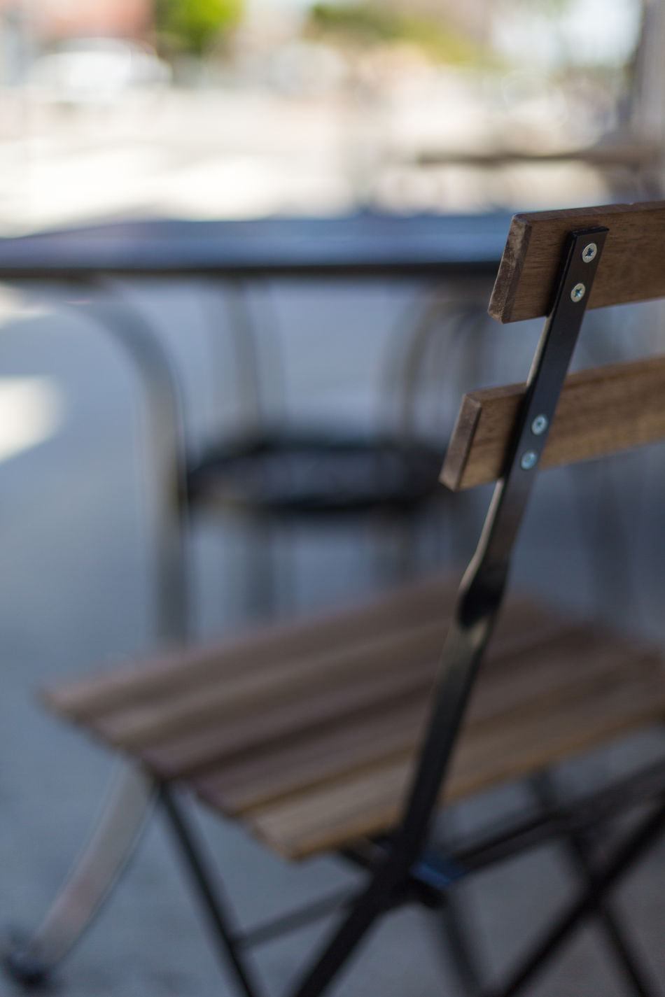 cafe tables and chairs Architecture Building Building Exterior Cafe Cafe Entrance Chairs City Close-up Day Door Focus On Foreground Metal Tables Morning No People Outdoors Patio Roads Shade Shaded Shallow Depth Of Field Street Tables Town Urban Windows