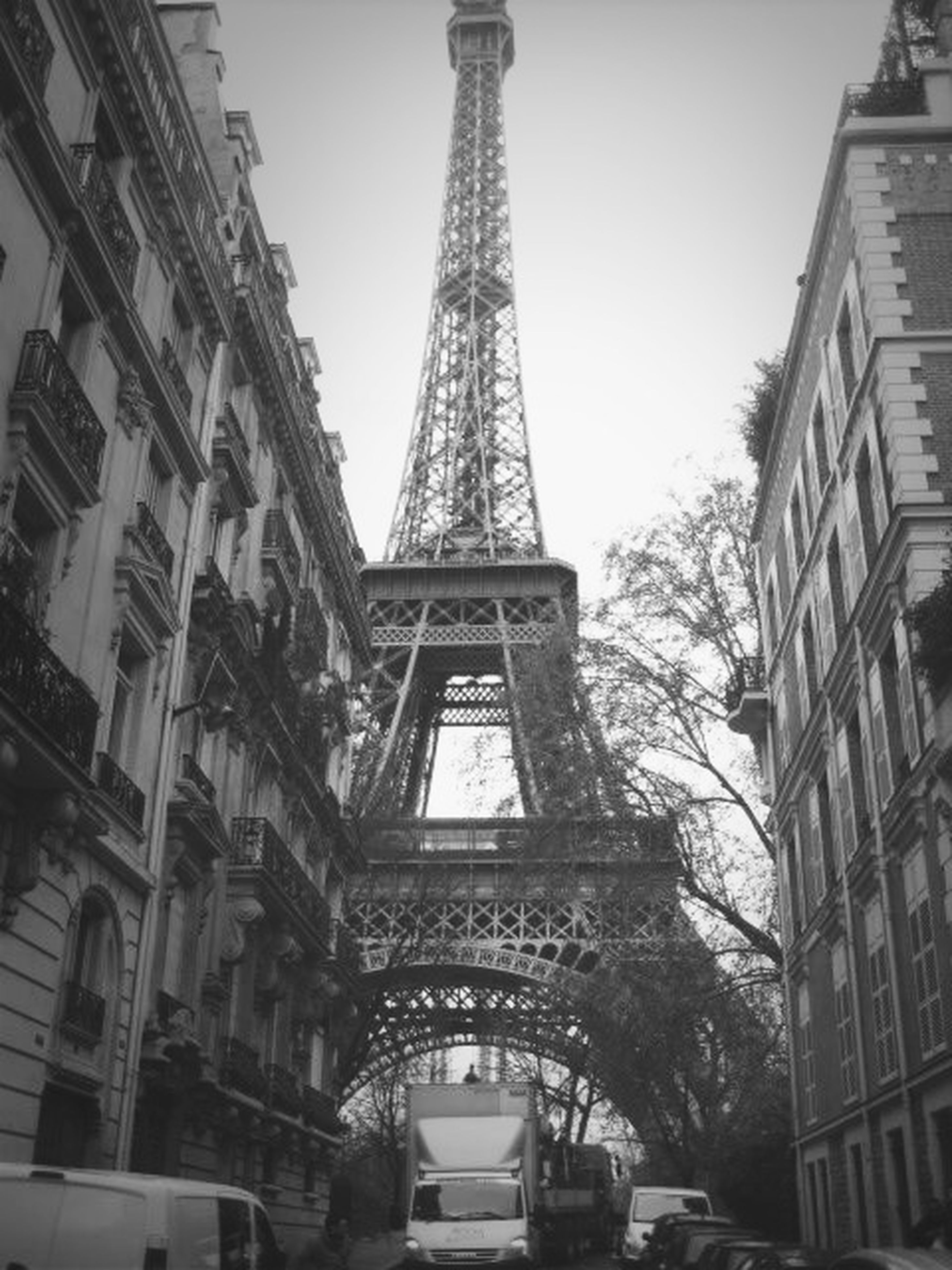 architecture, built structure, building exterior, low angle view, tower, tall - high, eiffel tower, city, travel destinations, capital cities, clear sky, famous place, history, culture, international landmark, tourism, day, travel, tall, sky