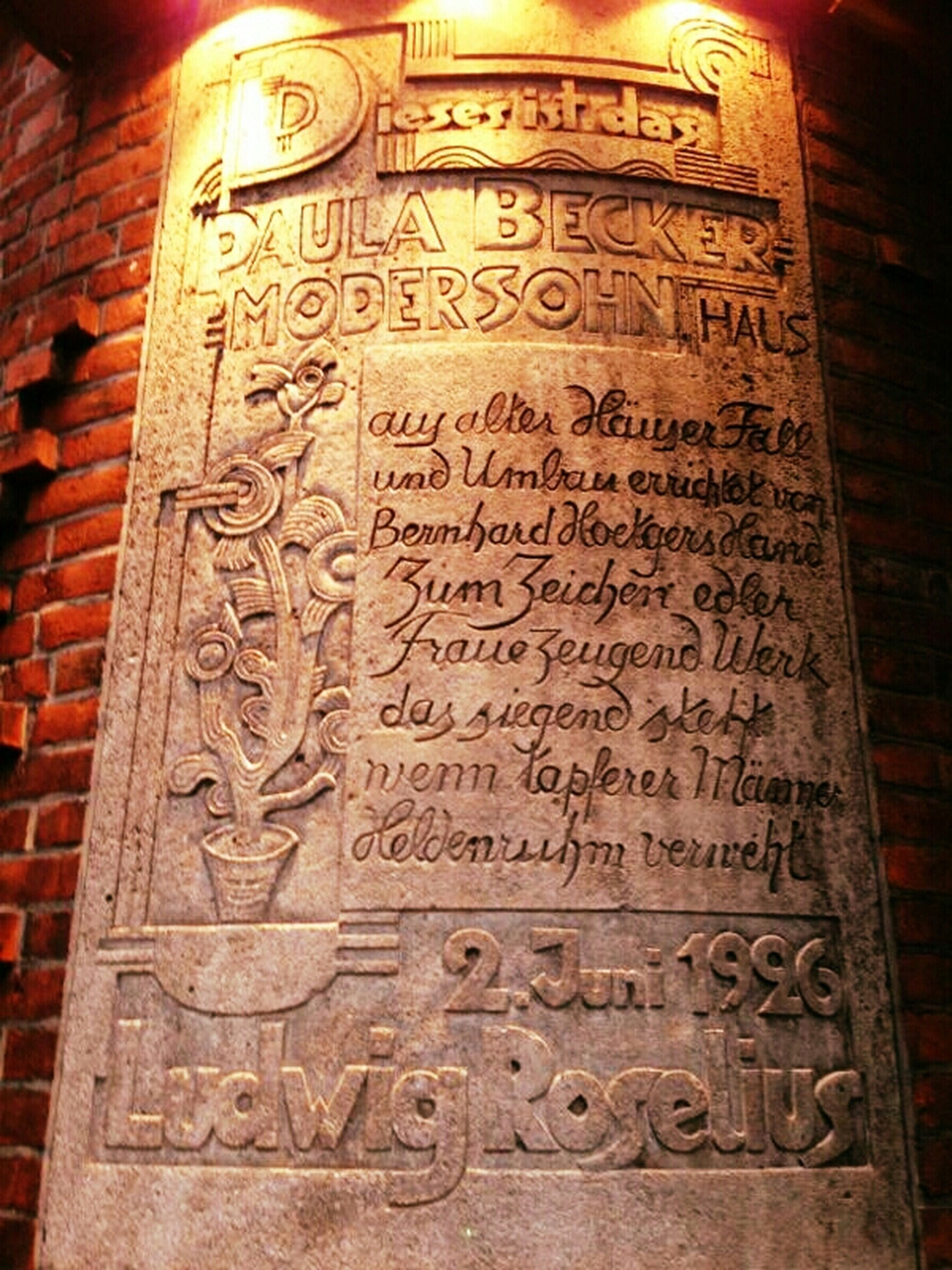 text, western script, communication, non-western script, information, art and craft, capital letter, art, history, human representation, creativity, close-up, no people, built structure, architecture, carving - craft product, number, indoors, old