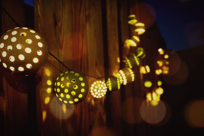 Illuminated Night Lantern Hanging Lighting Equipment Close-up Decoration Focus On Foreground Large Group Of Objects Multi Colored Green Color In A Row Holiday Culture Dark Outdoors No People Summer Night Lights Summer Nights