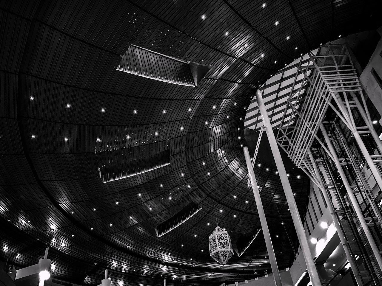 illuminated, indoors, architecture, night, built structure, modern, no people, city