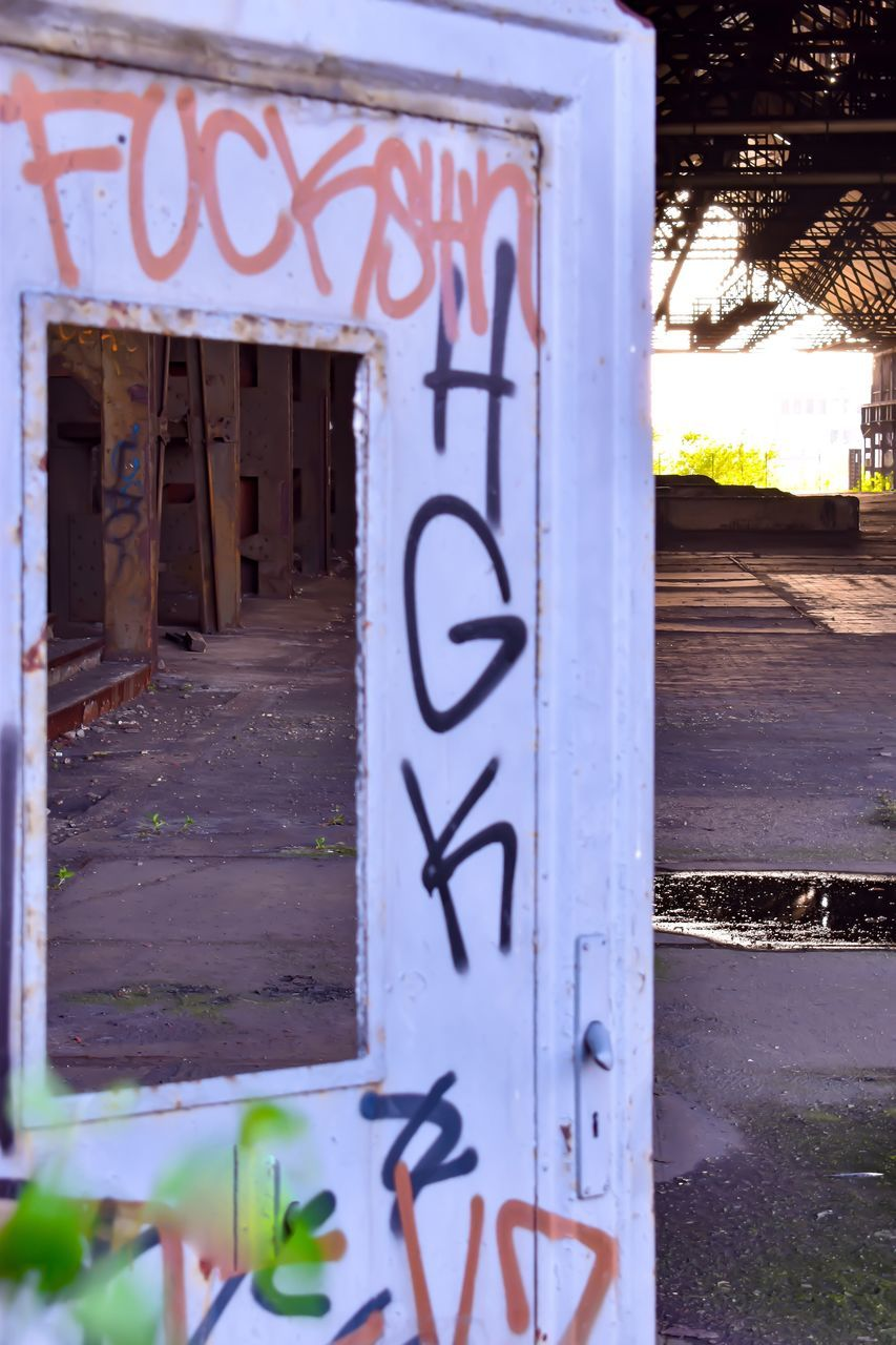 text, communication, graffiti, day, no people, built structure, outdoors, close-up, architecture