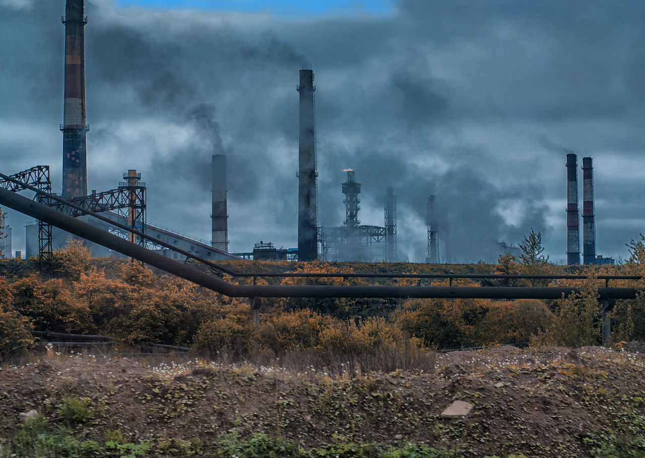 industry, smoke stack, air pollution, pollution, smoke - physical structure, factory, emitting, environment, environmental issues, fumes, built structure, fuel and power generation, chimney, outdoors, power station, day, no people, landscape, sky, architecture