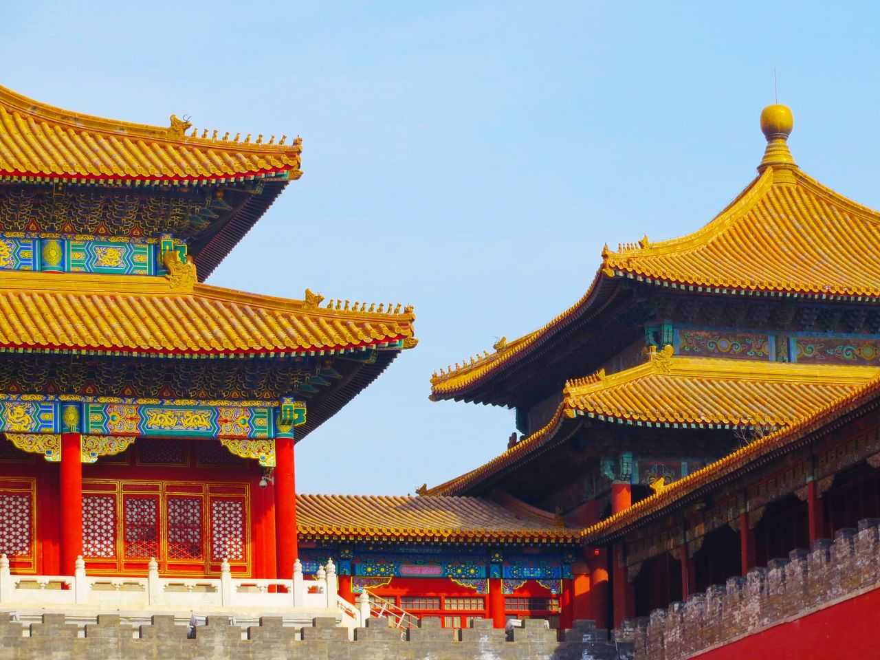 architecture, building exterior, built structure, religion, roof, place of worship, eaves, traditional building, travel destinations, gold colored, cultures, day, no people, spirituality, low angle view, outdoors, sky, clear sky
