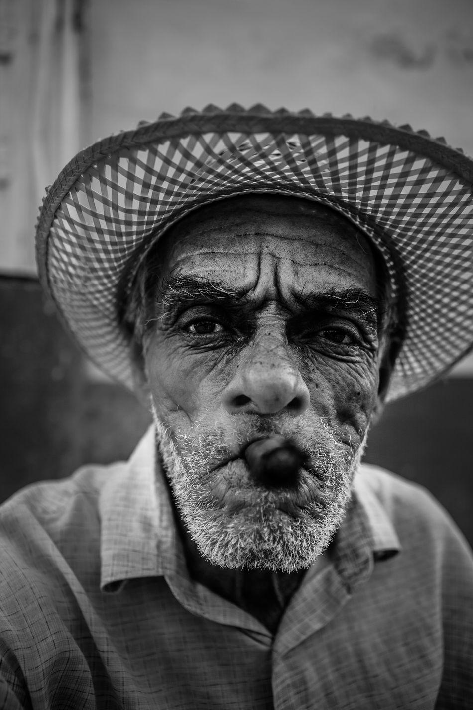 A cuban man poses for tourist' pictures. Cuba Cuban Man Portrait Sigar Straw Hat Travel Trinidad