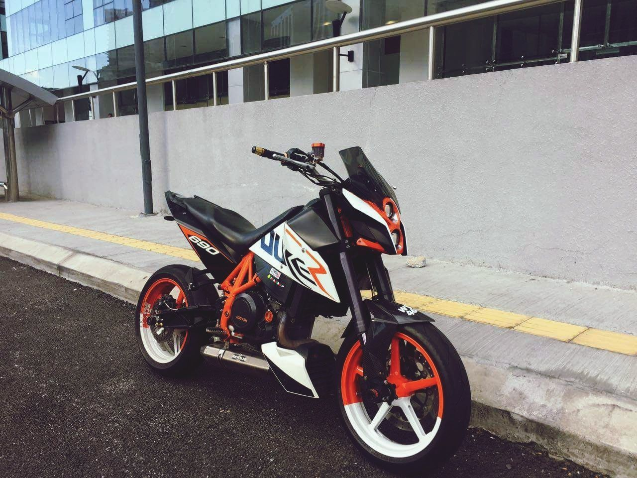 transportation, land vehicle, mode of transport, building exterior, built structure, architecture, stationary, outdoors, day, scooter, motorcycle, no people, helmet