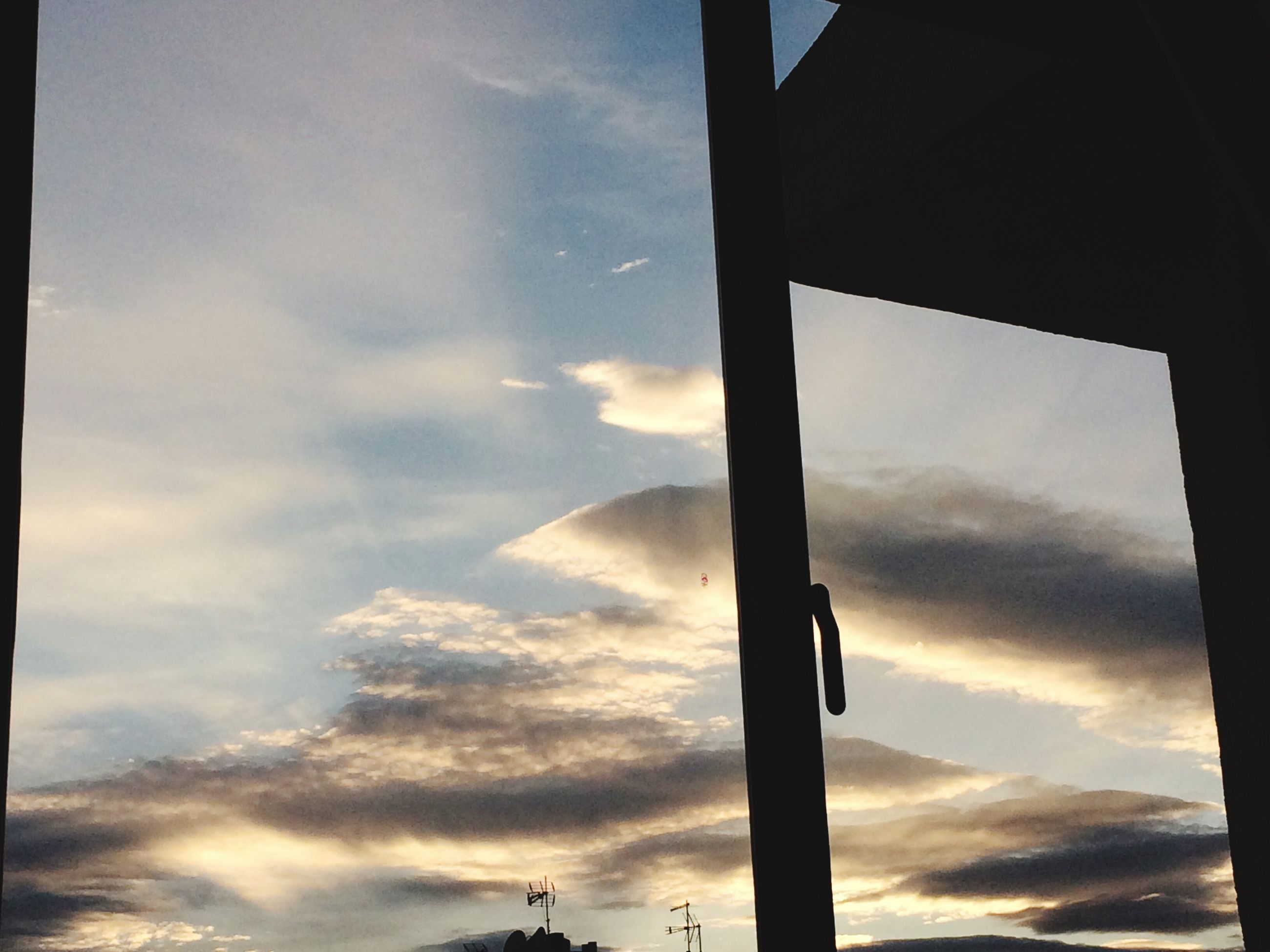 low angle view, sky, cloud - sky, cloudy, silhouette, cloud, built structure, architecture, sunset, street light, no people, pole, outdoors, nature, sunlight, day, overcast, weather, dusk, tranquility