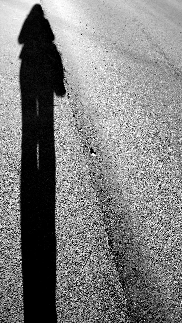 Shadow Of Woman On Sidewalk