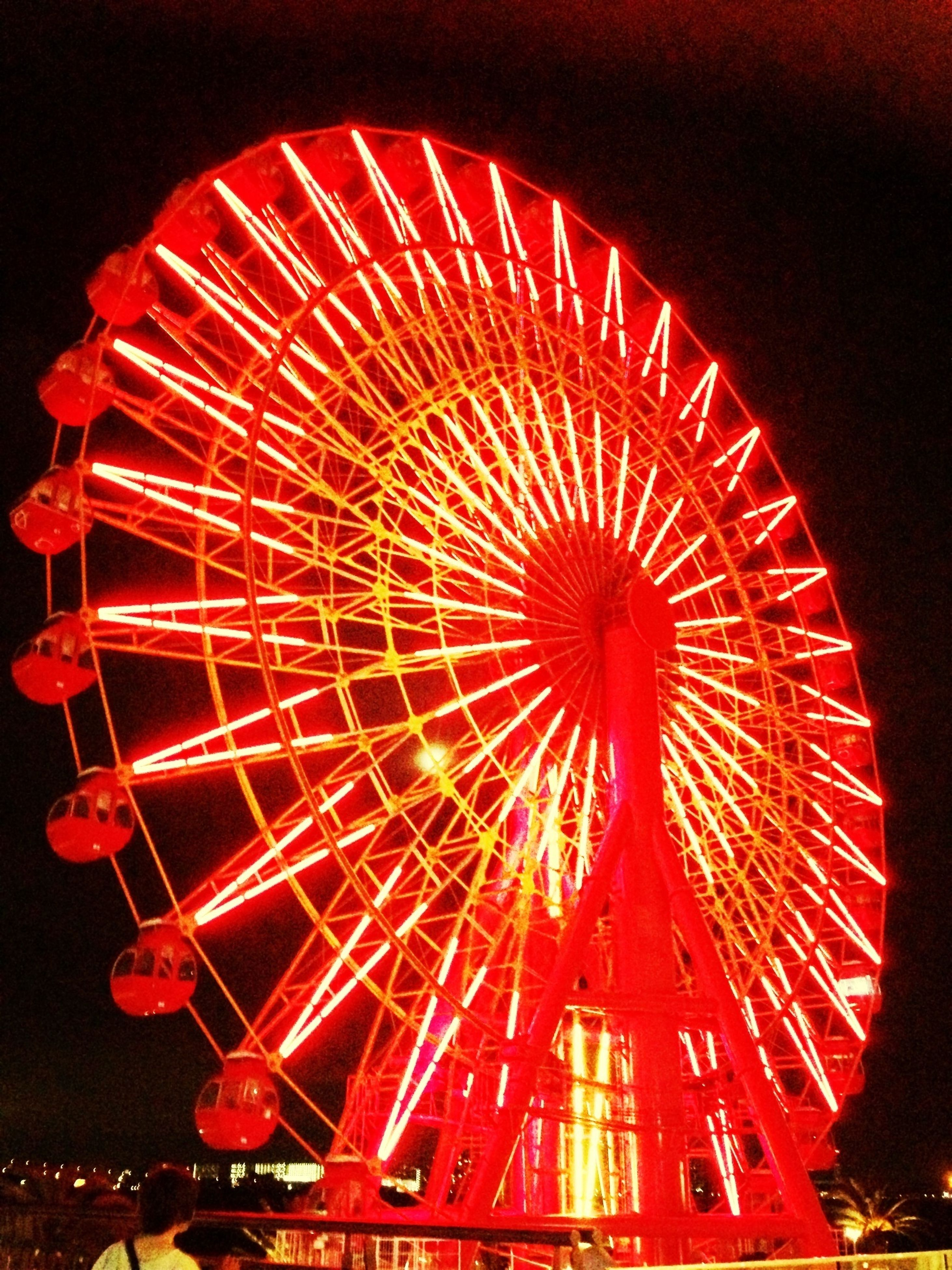 arts culture and entertainment, red, amusement park, amusement park ride, ferris wheel, illuminated, low angle view, night, circle, sky, celebration, fun, outdoors, clear sky, no people, cultures, tradition, big wheel, built structure, decoration