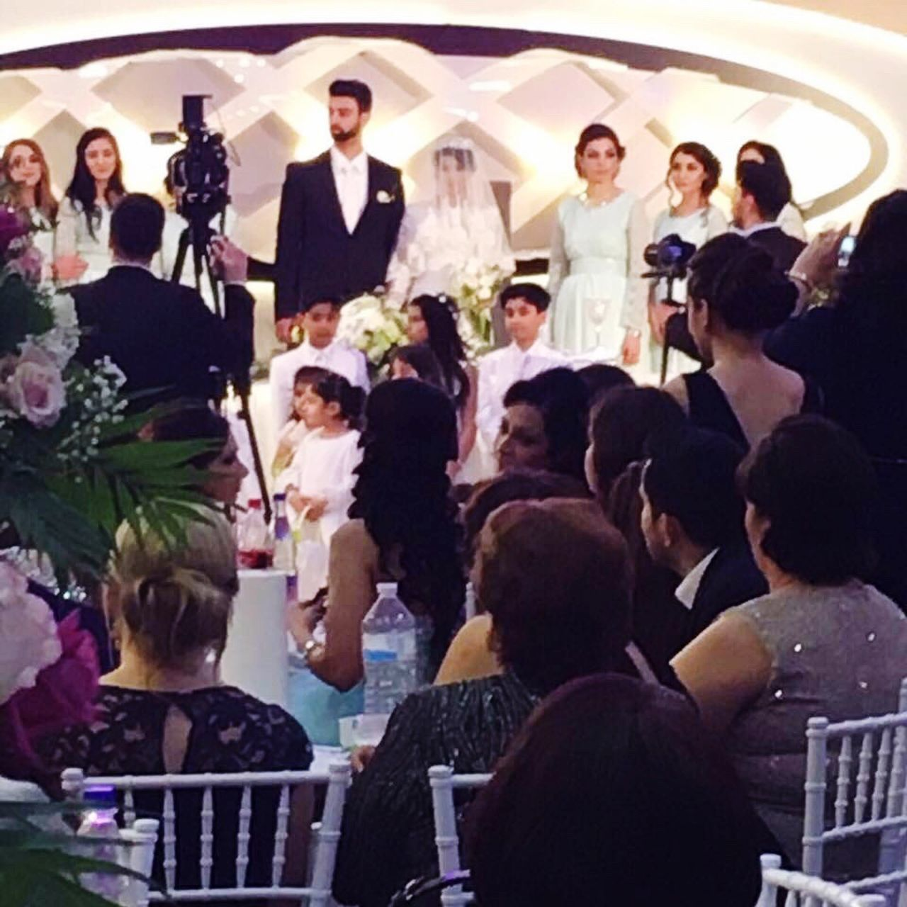 large group of people, men, women, ceremony, standing, indoors, people, well-dressed, audience, adult, bride, bridegroom, day, adults only