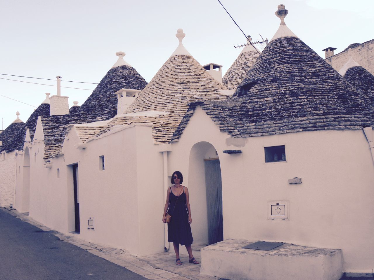 Alberobello Alberobello - Puglia Alberobello City Alberobellocity Alberobelloexperience Alberobellophotocontest Architecture Building Exterior Built Structure Day Front View Full Length House Lifestyles Looking At Camera One Person Outdoors People Portrait Real People Standing Young Adult Young Women