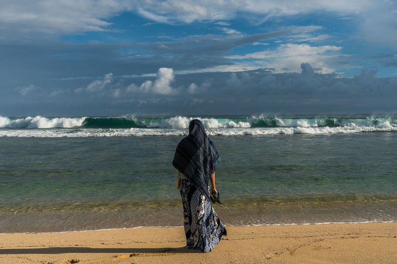 Calm storm Travel Calm Storm Waves Thoughts Peace Islam Muslim Religion Lonely Beach Sea Water Sand Rear View Women Only Women Lifestyles Nature Vacations Wave Real People