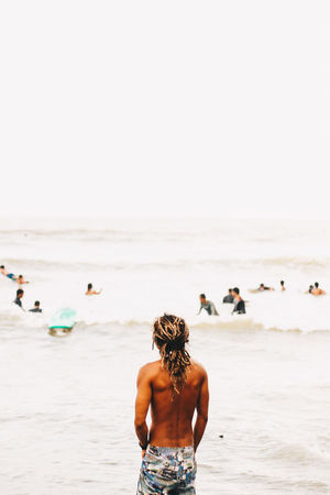 A local surfer from Baler, Philippines. Adult Beach Beachlife Day Horizon Over Water Leisure Activity Locals Men Outdoors People People Watching Rear View Sea Summer Surf Surfer Swimming Tropical Paradise Vacations Water Wave