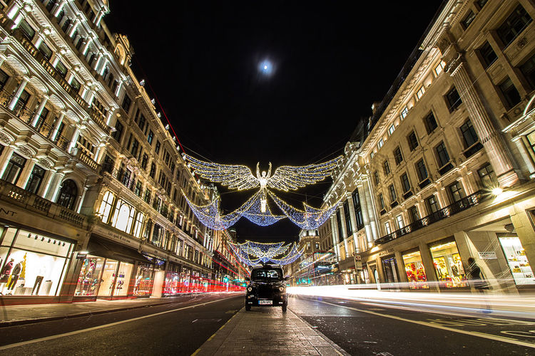 Christmas Christmas Lights Lights London Moon Shopping Taxi Angel Architecture Black Cab Building Exterior Built Structure Cab City Illuminated Illumination Motion Night Outdoors Real People Sky Sreet The Way Forward