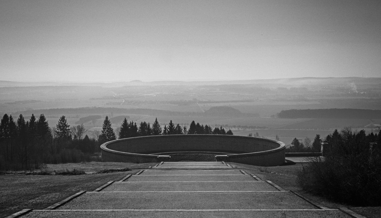 A truely dark and disturbing place: The Memorial of Buchenwald concentration camp. Shot at partial solar eclipse in 2015. Architecture Buchenwald Concentration Camp Concentrationcamp Dark Place Death Holocaust Hope Hopeless Memorial Mourning Pain Sadness Solar Eclipse Sun Torture World War II Black & White Blackandwhite Photography Black And White The Architect - 2016 EyeEm Awards