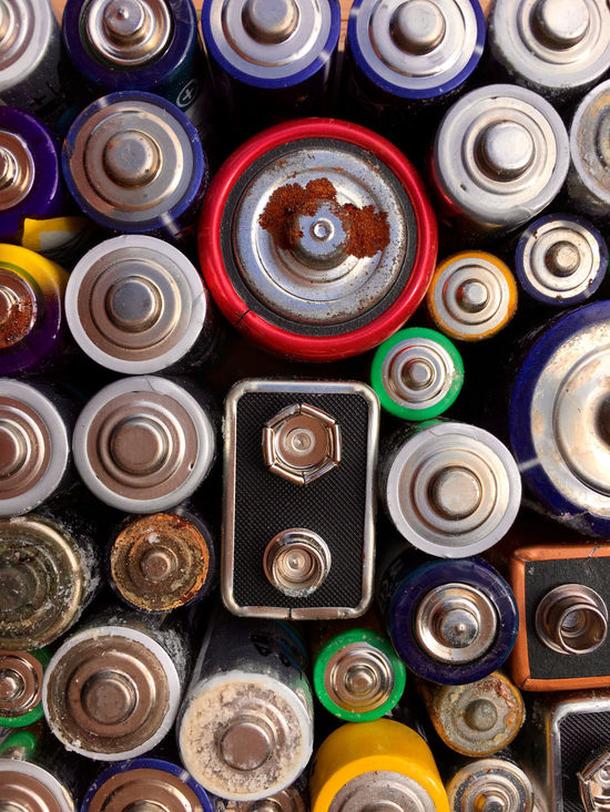 High angle view of old and used batteries for recycling Aerosol Can Alkaline Battery Choice Day Energy Environment Full Frame Indoors  Ion Large Group Of Objects Lithium Metal Multi Colored Nickel No People Old Power Recharge Recycling Rust Rusty Things Used Variation Voltage