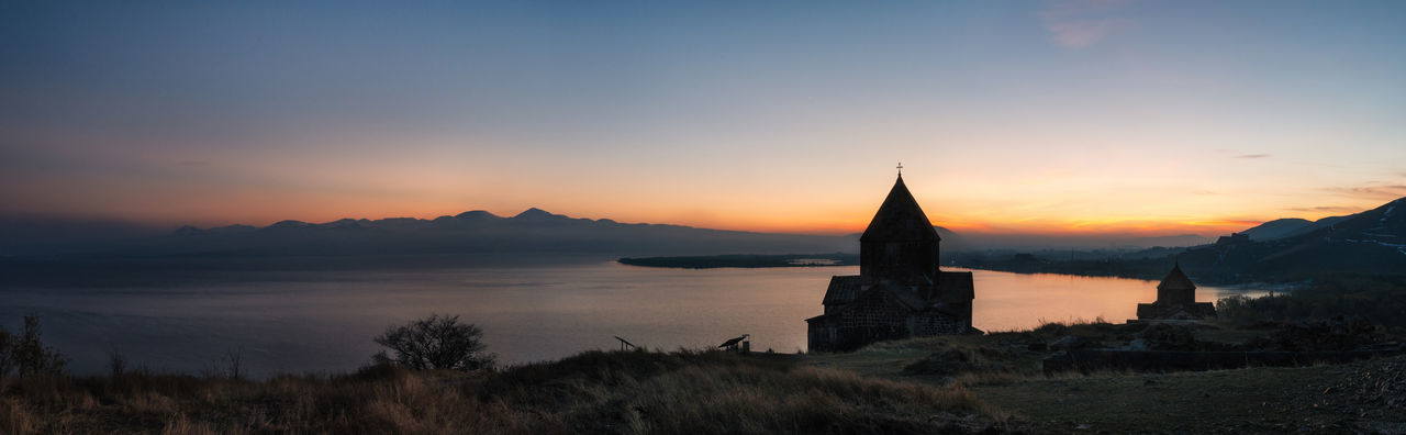 Panoramic view of the temple complex on the Sevan Lake at sunset, Armenia. Silhouettes of St. Jakob Church and Sevanavank. Armenian landmarks Ancient Ancient Architecture Architecture Armenia Christianity Church Dusk Idyllic Lake Landscape Monastery Nature Outdoors Place Of Worship Religion Scenics Sevan Sky Sunset Sunset Silhouettes Sunset_collection Travel Destinations Water