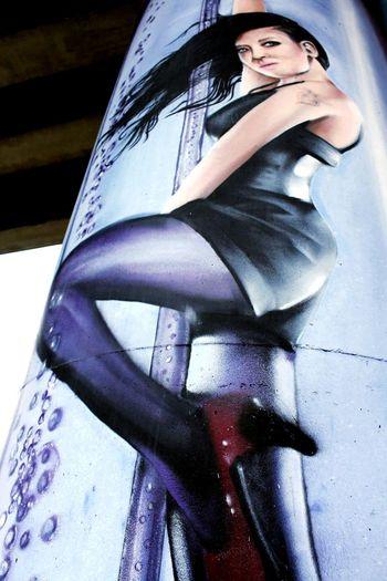 Low Angle View Outdoors One Person Stripers Streetphotography Graffiti Art Graffiti Graffiti Photography Graffiti & Streetart WomeninBusiness Women Blackhair Sexygirl Street Outdoor Photography City ArtWork Paint Painted Image Adult EyEmNewHere