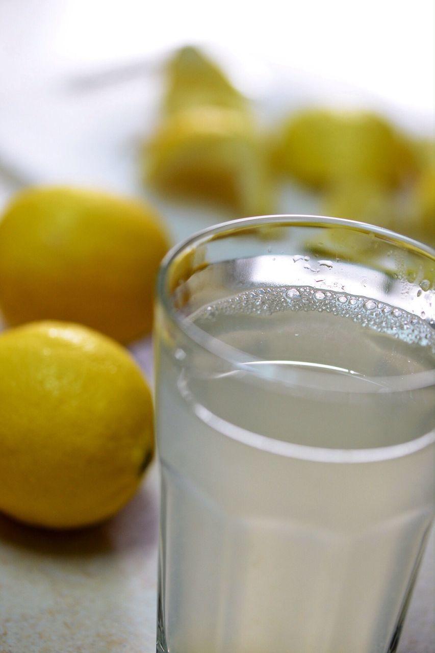 Close-up of lemon juice with lemons