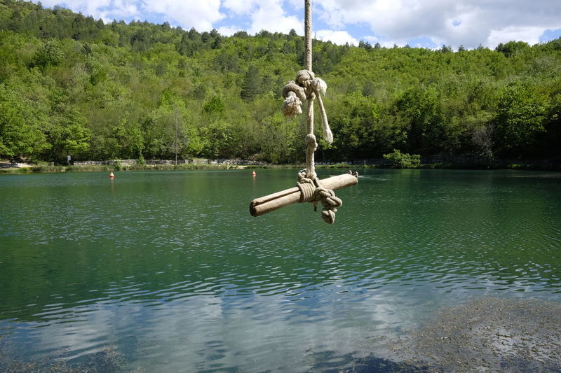 Rope for jumping into the lake Chain Cloud - Sky Day Hanging Jumping Lake Nature No People Outdoors Rope Rope Swing Sinizzo Sky Swing Tree Water Waterfront