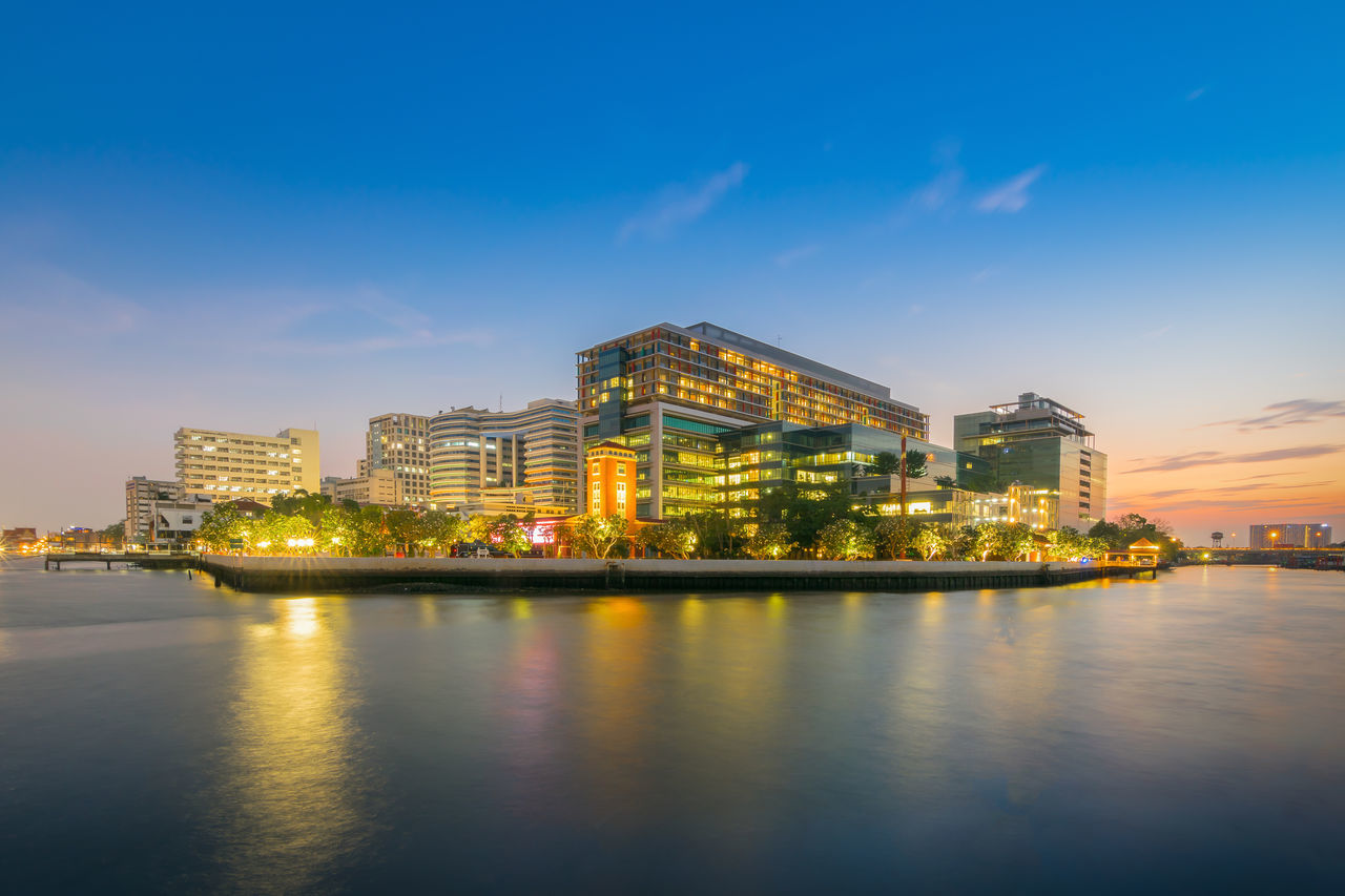 Beautiful scene of Siriraj Hospital in Bangkok , Thailand at sunset Architecture Blue Building Building Exterior City Cityscape Modern Nature No People Outdoors Reflection Residential District River Sky Water Waterfront