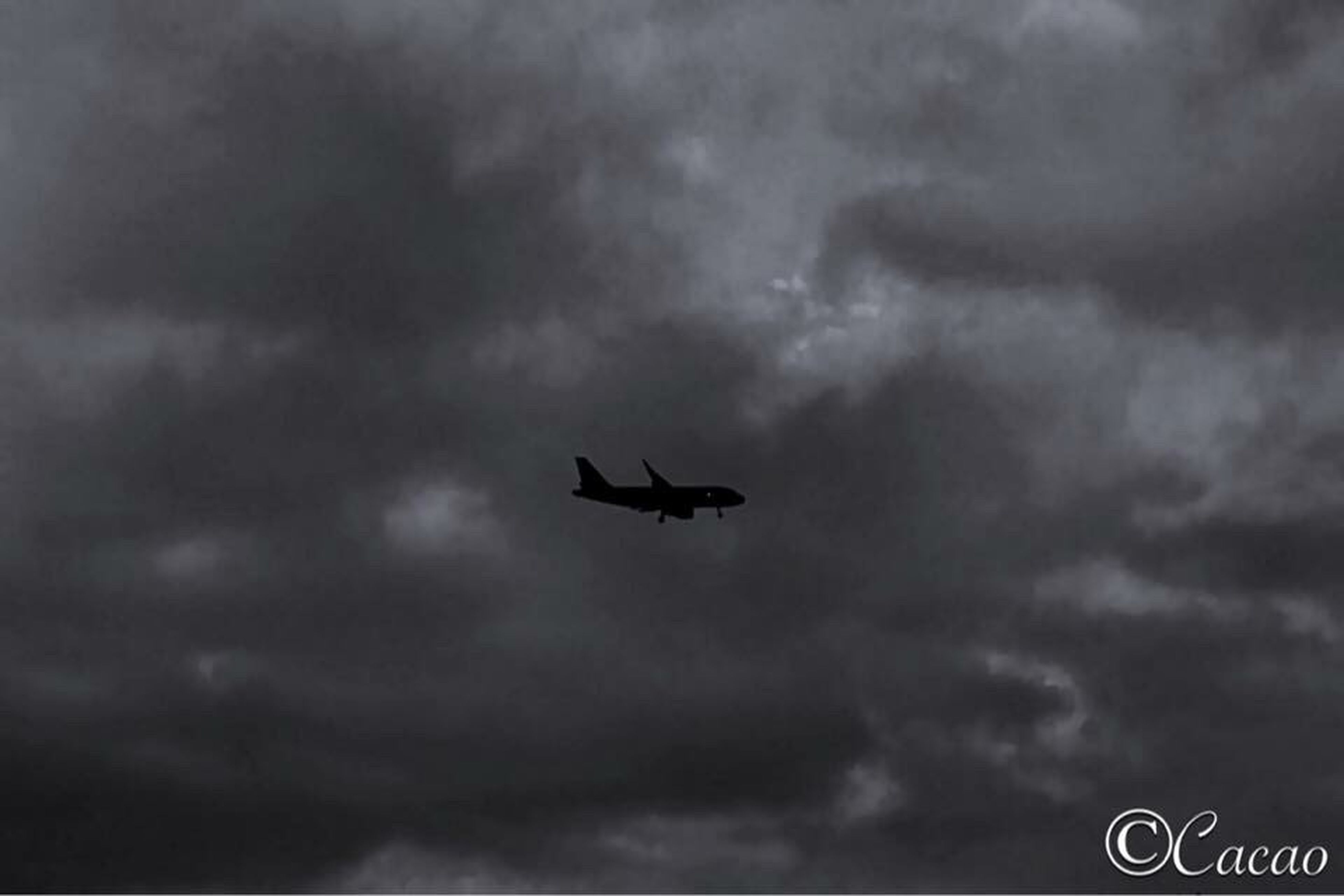 mode of transport, transportation, airplane, flying, air vehicle, mid-air, travel, low angle view, silhouette, on the move, sky, flight, journey, cloudscape, cloud, cloud - sky, aircraft, airways, scenics, outdoors, majestic, nature, ominous, day, no people, atmospheric mood, tranquility, tranquil scene, cloudy