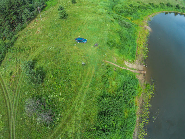 The view from the height of the river Mologa and the car next to the river bank. Aerial Aerial View Car Green Color Growth High Angle View Mologa Nature No People Outdoors River Russia Vehicle