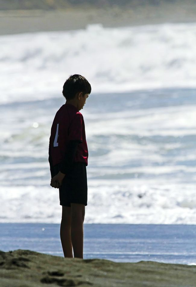 Boy Stands At Sea Thebeach Sea A Lone Waves Sea And Sky Sunlight Daydreaming Lookingdown Photo Of The Day NiceShot