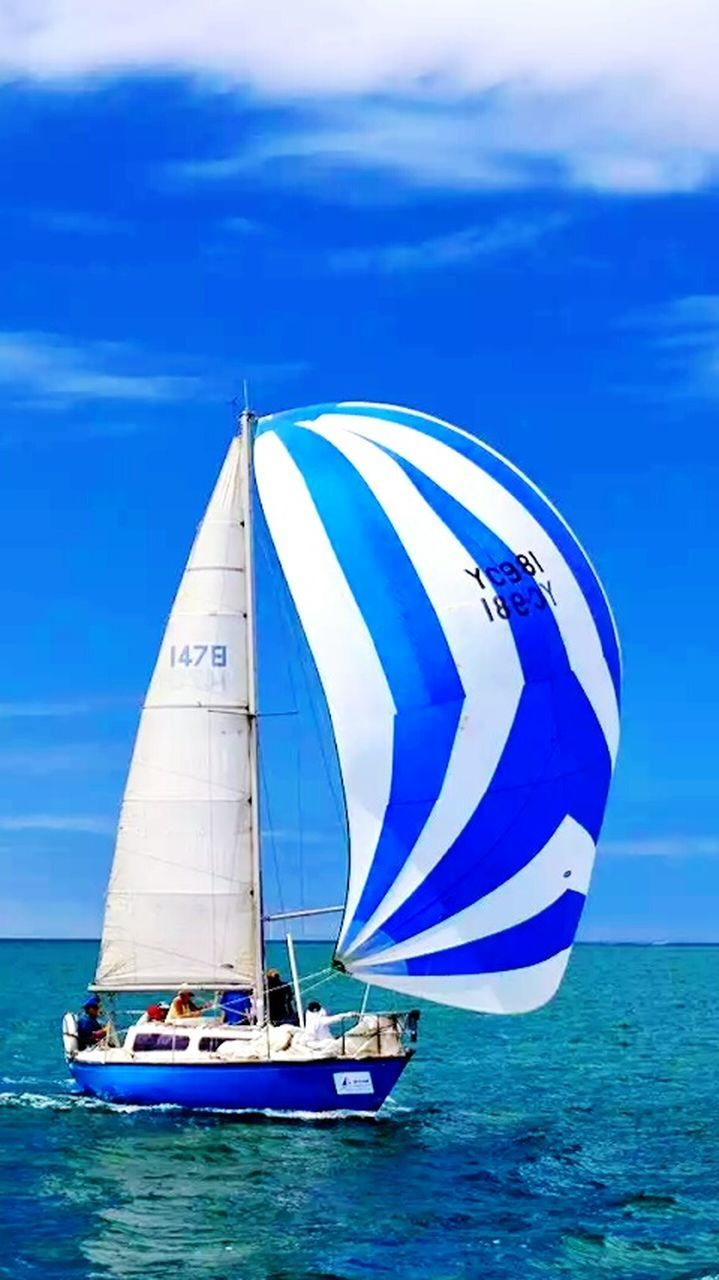 sea, nautical vessel, transportation, blue, sailboat, water, sky, sailing, mode of transport, cloud - sky, horizon over water, beach, adventure, leisure activity, outdoors, day, yacht, vacations, sport, sailing ship, nature, mast, yachting, no people