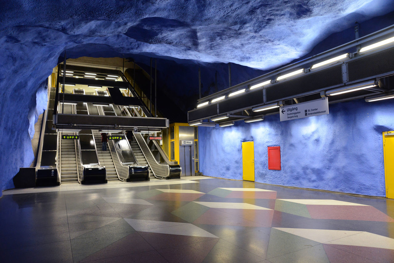 Mural Paintings Cave Ceiling Ceiling Design Escalator Illuminated Light Blue Metro Motion People Rolling Stairs Stockholm Stockholm Metro T-centralen Modern Architecture Stockholm, Sweden Feel The Journey