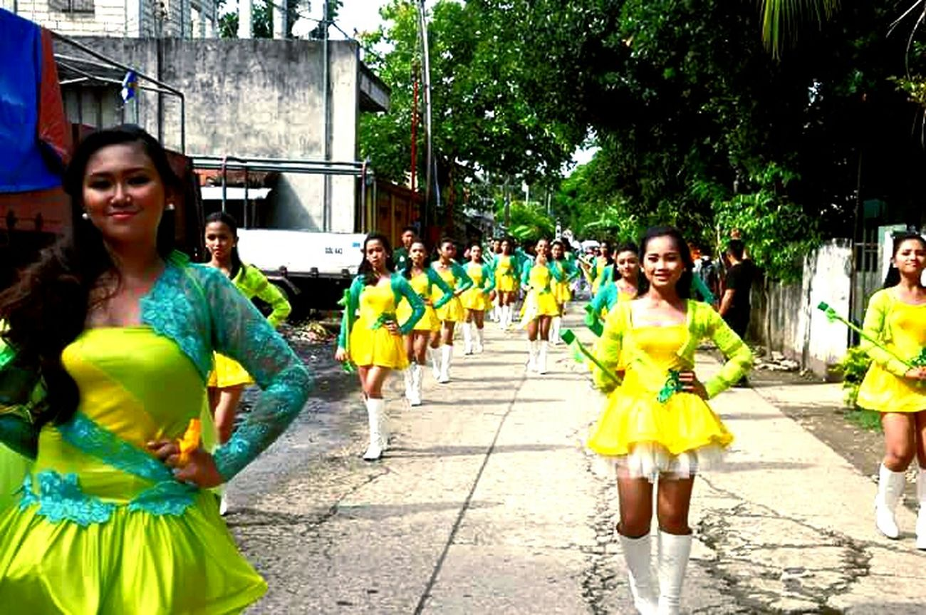 Argao Opening Parade 2k16 Leisure Activity Looking At Camera Lifestyles Casual Clothing Portrait Girls Childhood Elementary Age Togetherness Person Front View Bonding Full Length Holding Green Color Day