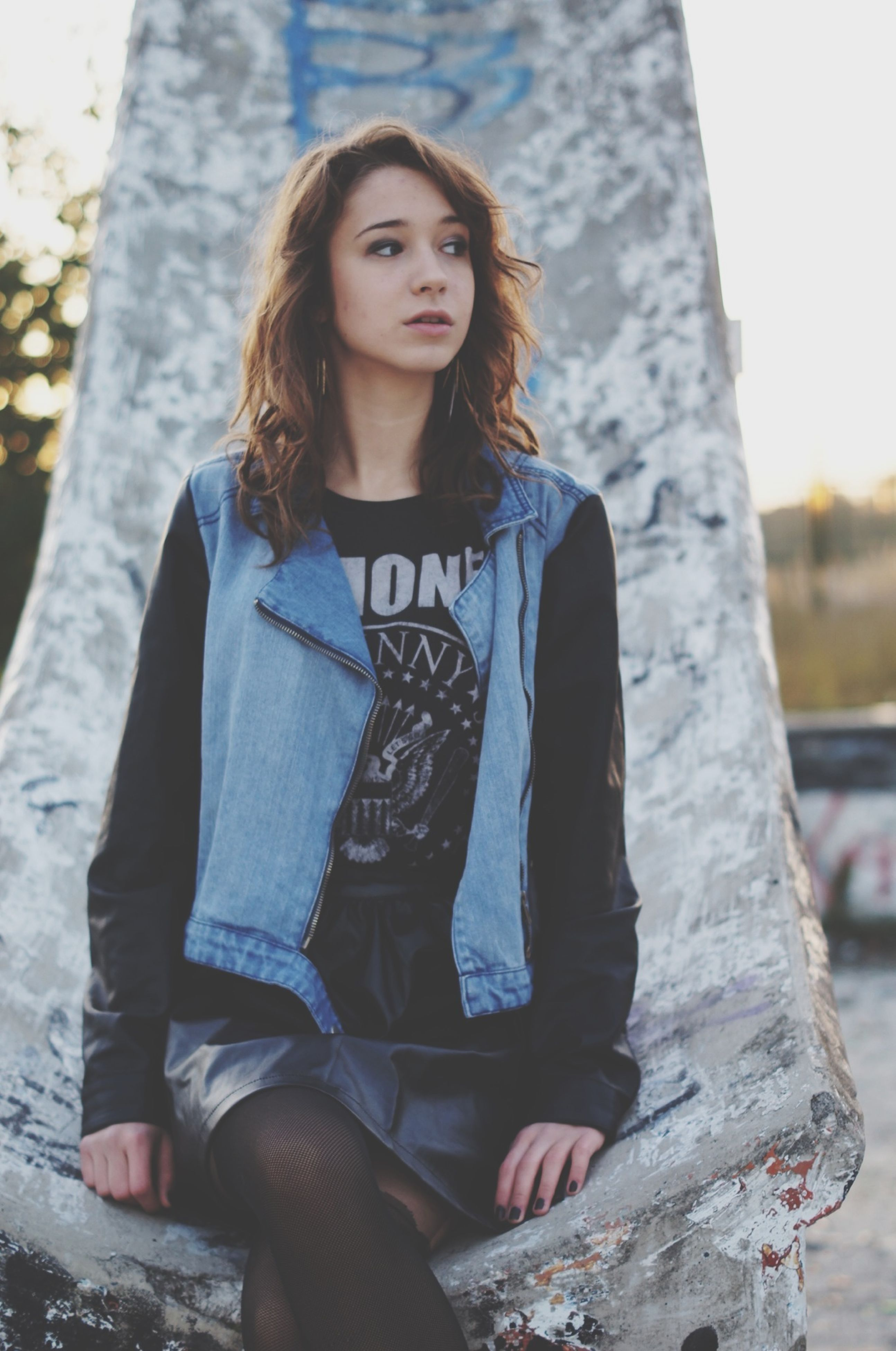 lifestyles, casual clothing, person, young adult, looking at camera, portrait, leisure activity, standing, front view, young women, three quarter length, focus on foreground, long hair, day, outdoors, warm clothing, waist up