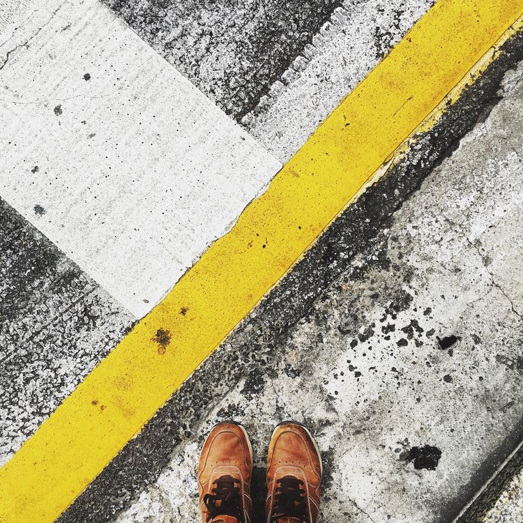 Urban painting Road Marking Low Section Yellow Person Personal Perspective Standing Road Shoe Transportation Street High Angle View Directly Above Human Foot Yellow Line Guidance Leisure Activity Lifestyles Men Footwear Urban Geometry Rockport Texture Pavement Pavement Patterns