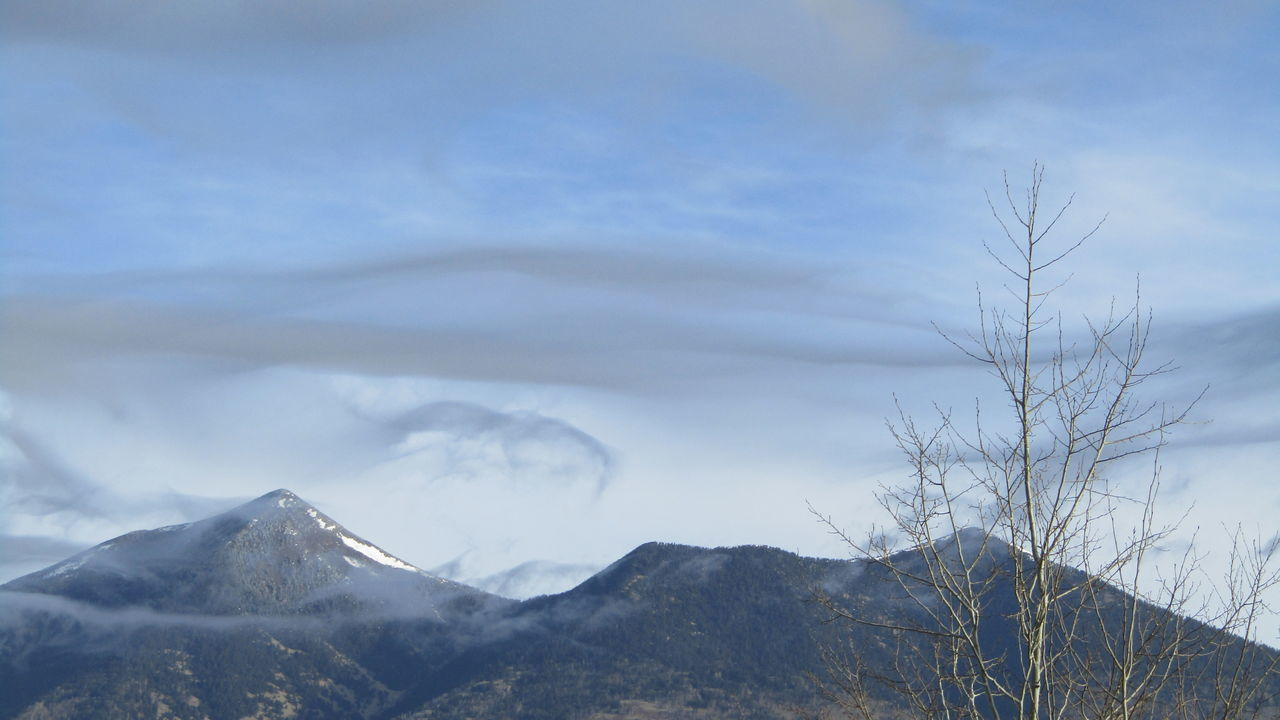 Beauty In Nature Cloud Cloud - Sky Cloudy Day Idyllic Landscape Mountain Mountain Range Nature Non-urban Scene Outdoors Remote Scenics Sky Snow Tranquil Scene Tranquility Weather Winter