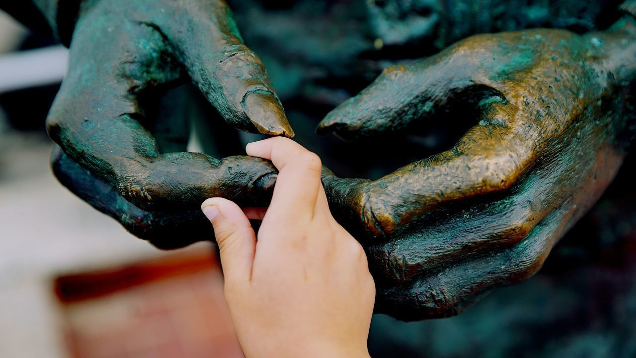 human hand, human body part, human finger, real people, holding, one person, sculpture, statue, day, close-up, outdoors, working, animal themes, nature, people