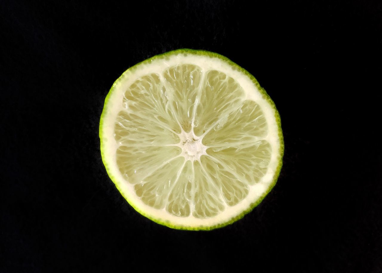 Sliced lime. Lime Slice Sliced Lime SLICE Citrus Fruit Single Object Fruit Black Background Food And Drink Healthy Eating Freshness Close-up Halved Cross Section Food Sour Squeezing Juicy