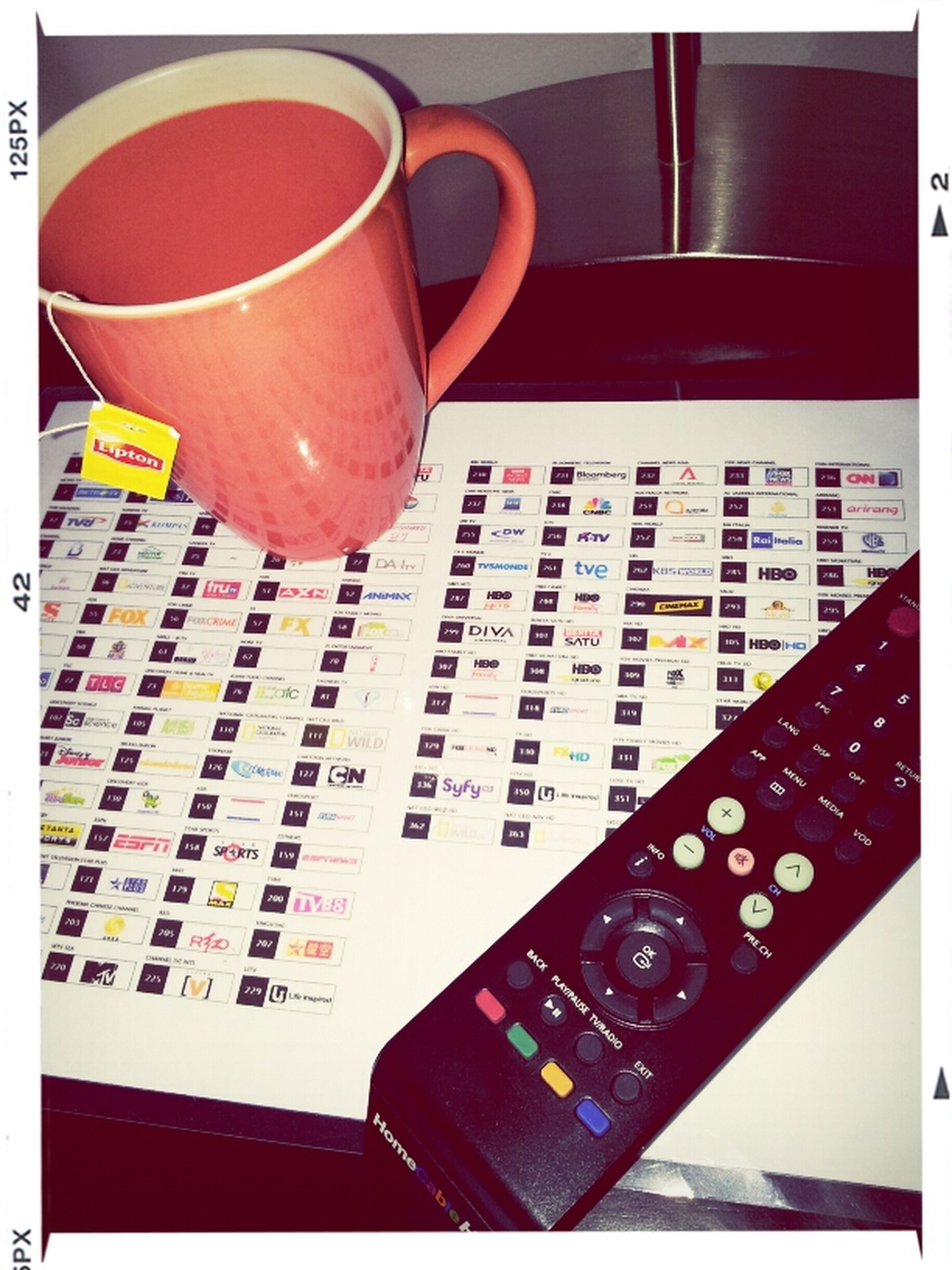 indoors, transfer print, auto post production filter, still life, table, communication, close-up, text, high angle view, no people, western script, technology, red, book, education, drink, coffee cup, empty, absence, paper