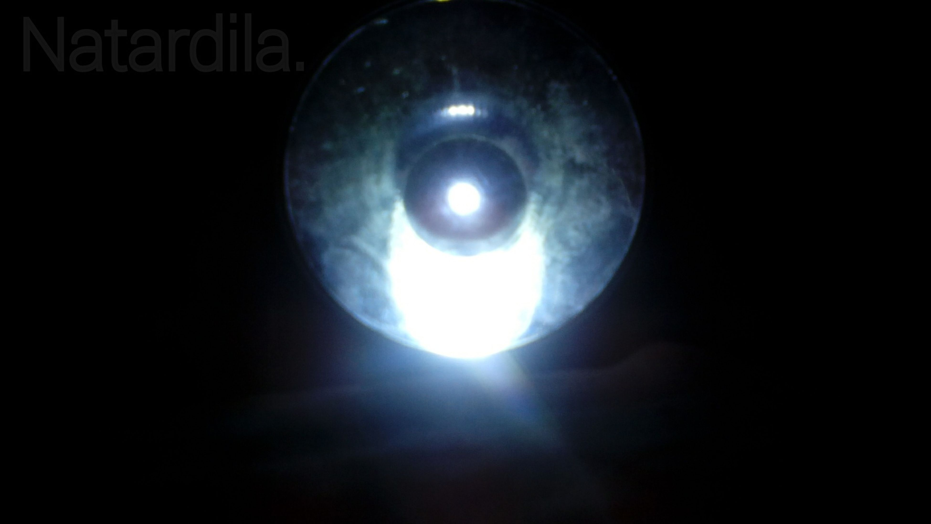 illuminated, lighting equipment, low angle view, electricity, light bulb, night, circle, glowing, ceiling, indoors, electric lamp, electric light, dark, light - natural phenomenon, close-up, sphere, hanging, copy space, lamp, no people