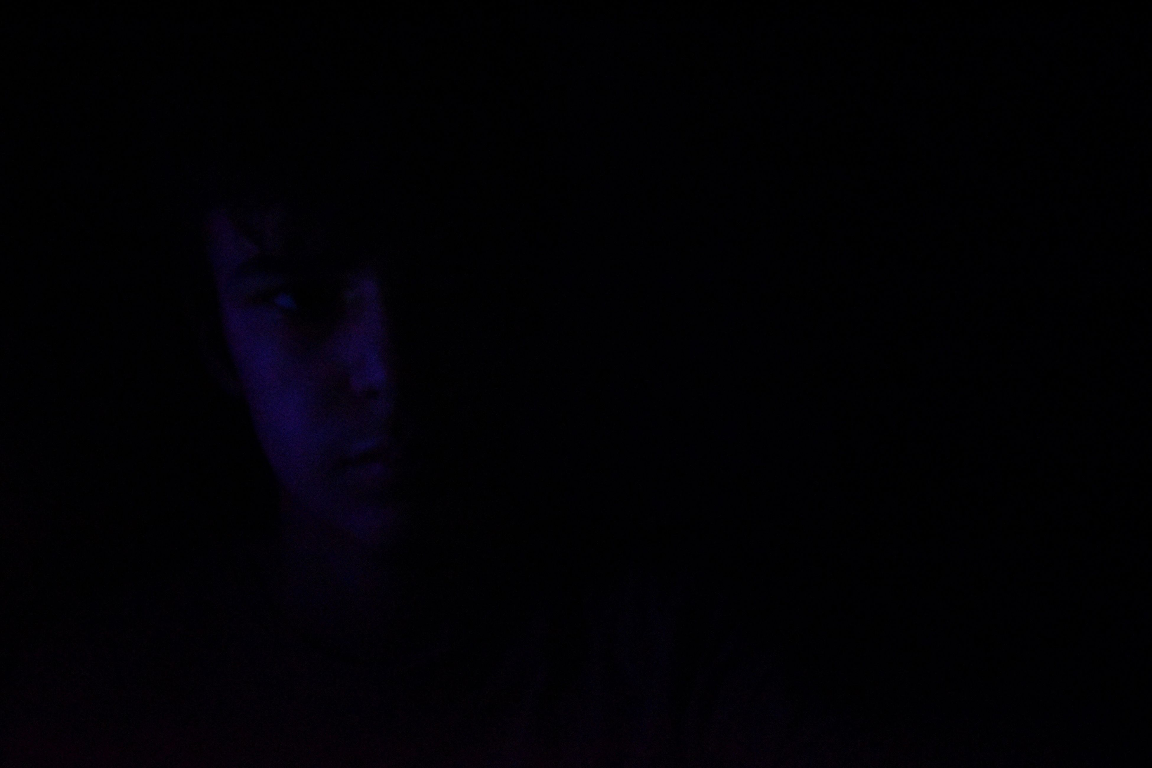 copy space, black background, studio shot, blue, dark, purple, human body part, close-up, real people, darkroom, night, one person, people