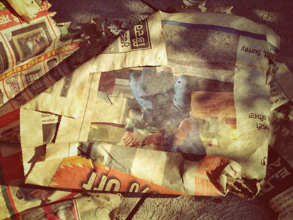 Beautiful stock photos of newspaper, Damaged, Day, High Angle View, Newspaper