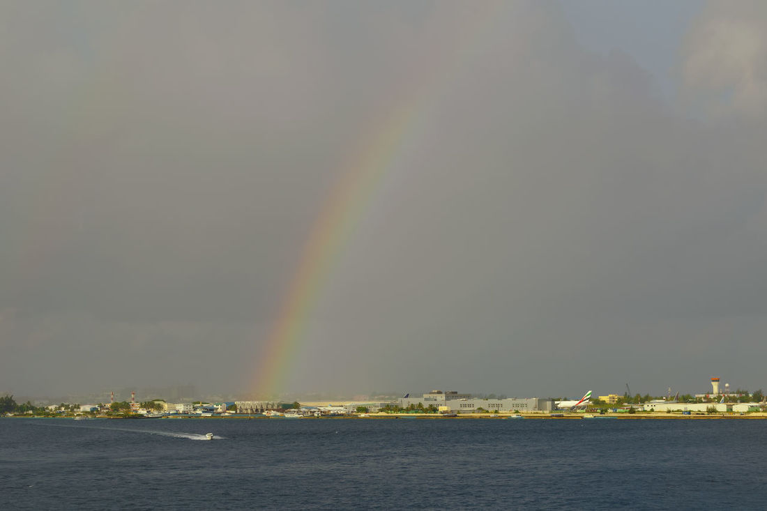 Rainbow Double Rainbow Outdoors Sea Beauty In Nature Nature Refraction Spectrum Multi Colored Cityscape Water Sky Maldives