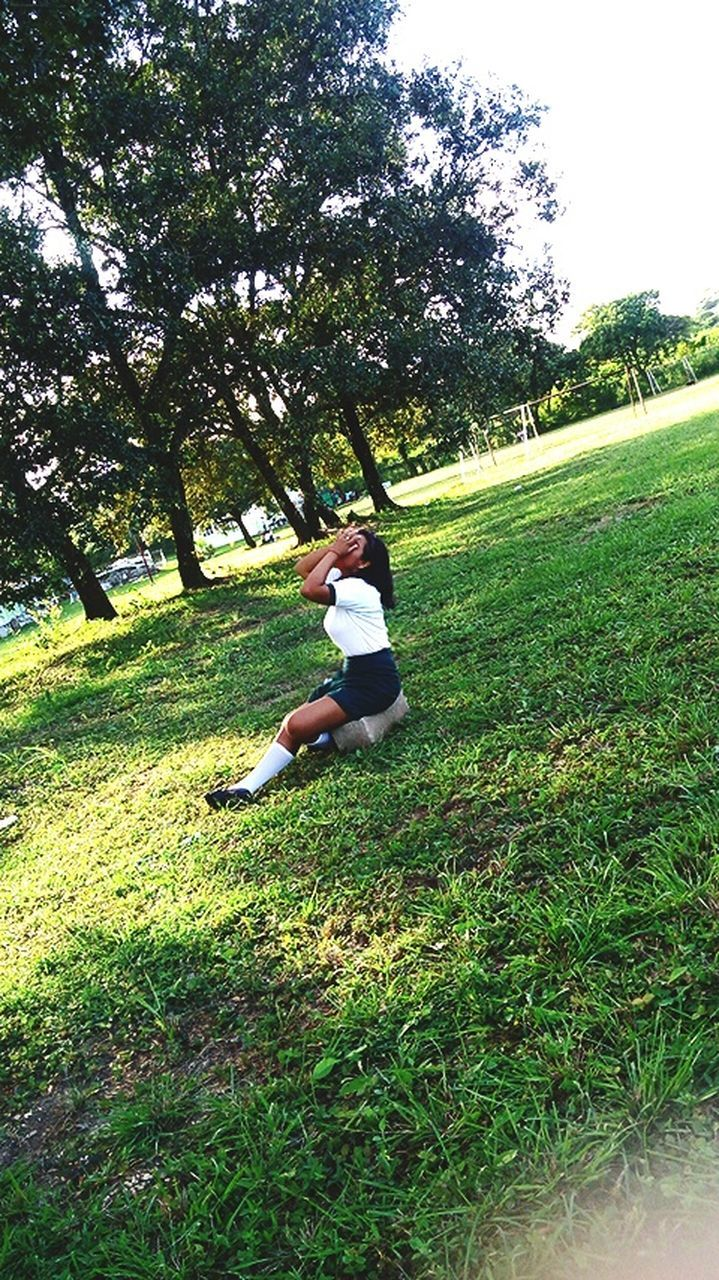 grass, nature, tree, day, green color, growth, full length, field, one person, leisure activity, tranquility, lifestyles, healthy lifestyle, outdoors, real people, sitting, women, young women, beauty in nature, young adult, people